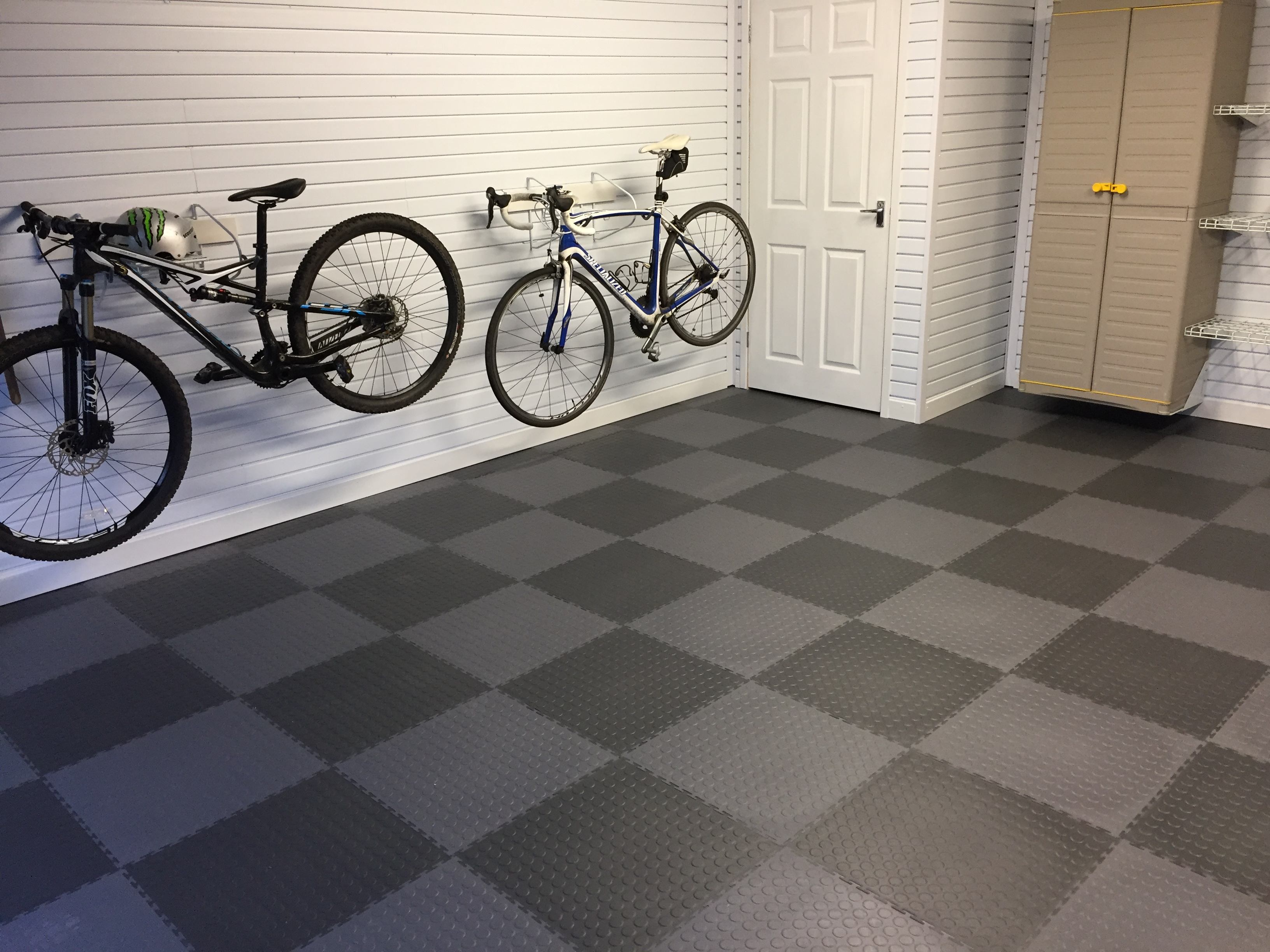 Checkerboard pattern showcased in this garage floor installation by Garageflex