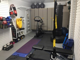 Floor TIles make a good floor solution for a home gym by Garageflex